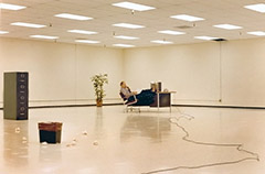 photo of lonely office worker in huge, empty office space